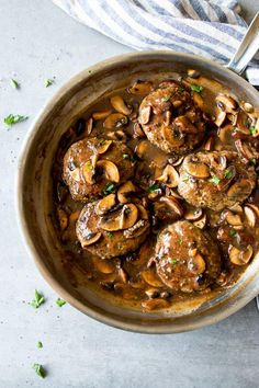 """""""This Salisbury Steak with Mushroom Gravy recipe is nothing short of amazing! Juicy ground beef patties are smothered in a luscious and rich mushroom sauce for the ultimate family dinner. Serve these the healthy way over mashed cauliflower with a side of broccoli to keep things low carb, or go fully traditional with mashed potatoes and peas. Either way, this is a budget friendly, economical comfort food dinner that's easy to make and super yummy to eat!"""""""