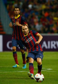 Andrés Iniesta of Barcelona FC passes the ball during the friendly match between FC Barcelona and Malaysia at Shah Alam Stadium on August 10, 2013 in Kuala Lumpur, Malaysia.