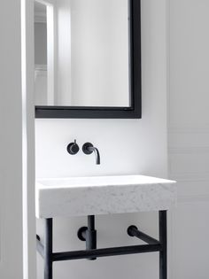 Modern meets traditional with a washstand on iron legs and a contemporary basin shape above. Paris-apartment-interior-by-Nicolas-Schuybroek #washstand #basin #bathroom