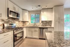 Nice cabinet color/granite:  Contemporary Kitchen with High ceiling, flush light, Flush, Ceramic Tile, Kitchen island, Flat panel cabinets, L-shaped