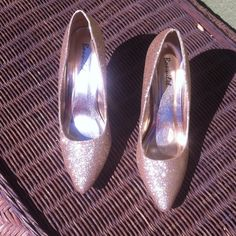 Gold pumps Sparkly gold pumps. Super cute and comfortable. Used once. Great condition! Like new! Shoes Heels