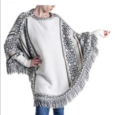 "NYE SALEVanilla Fringe Poncho✨ Keep warm and on-trend in this fun and stylish Muk Luks Women's Fringe Vanilla (off white) Poncho with sleeves. Featuring a vintage star design and fringe details. Acrylic material. 25"" long from high point of shoulder to hem. Sweaters Shrugs & Ponchos"