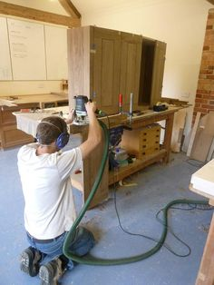 Mike fitting the English walnut curved doors on one of the the Bath kitchen cabinets. It's a very subtle kitchen! More workshop photos on our Twitter account: http://twitter.com/STPFurniture/
