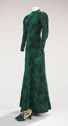 Evening ensemble, ca. 1938  Elsa Schiaparelli (Italian, 1890–1973); André Perugia (French, 1893–1977)  Green silk faille, metallic thread, gold kidskin, beige plastic