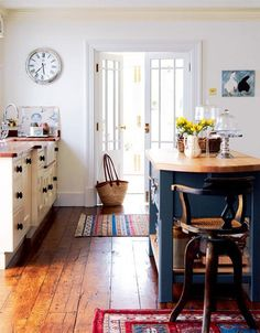 rustic wood floors, rugs, white and black cabinets/island (kitchen)