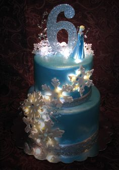 Blue, silver and white Frozen themed cake Frozen Themed Birthday Cake, Frozen Themed Birthday Party, Disney Frozen Birthday, 4th Birthday Cakes, Themed Cakes, Birthday Parties, Frozen Castle Cake, Frozen Cake, Pastel Frozen