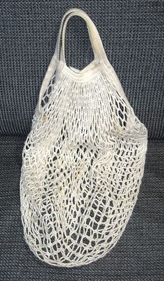 BYOB - Bring Your Own Bag - Try knitting a produce bag or a larger tote for all your market goodies.  A classic style string bag is amazingly expandable. - Foodista.com