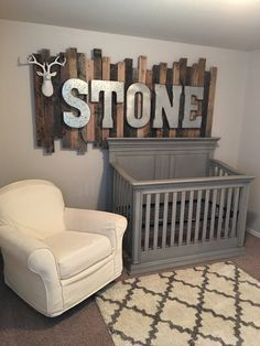 Rustic wood pallet sign with galvanized metal letters above the baby's crib!