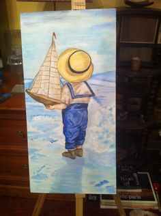 My little boy watching the beach contemplating putting his sailboat in the water! I painted this for my husband!