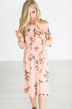 Floral dresses are all the rage, and for good reason! Pair it with a cute denim jacket, maybe a cardigan, or let it stand out on it's own. This gorgeous blush floral dress features buttery soft fabric