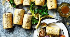 Reinvent a childhood favourite with these lentil sausage rolls with tomato sumac salad - tasty, wholesome and completely meat free!
