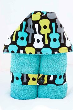 Toddler Hooded Towel-- Groovy Guitars on Turquoise. $19.00, via Etsy.