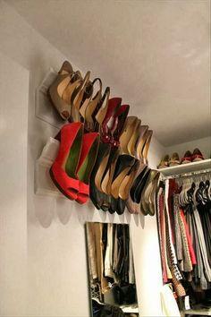 Shoe storage idea - crown molding shoe rack for the back of closet over shoe shelves.