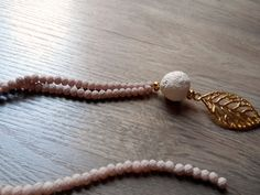 Long necklace with beads,  ceramic stone and gold leaf