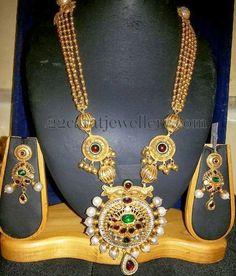 Jewellery Designs: Multi Strings Gold Set in Tourmalines