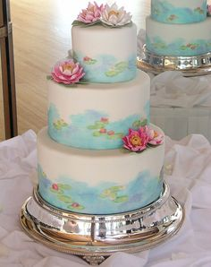 Lily pads on water wedding cake. Love!  | 10 Watercolour Wedding Cakes Almost Too Lovely To Eat via @weddingbellsmag