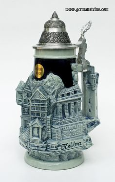 This cobalt blue stein has a relief wrap around decoration depicting three Rhine river towns - Koln am Rhein, Rudesheim and Koblenz. A castle tower makes the handle of this unique German beer stein Beer Glassware, Glass Beer Mugs, Fancy Tea Cups, German Beer Steins, More Beer, Beer Company, Craft Beer, Brewery, Backyard Lighting