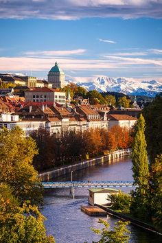 Zurich, view of the Limmat River and the Old Town with snowcapped Alps in the background. Alps, Old Town, Switzerland, River, Mansions, House Styles, Outdoor, Old City, Outdoors