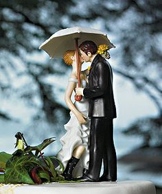 My cake topper! :D  Fits perfectly with us, my boyfriend proposed on a rainy day on the corner where we had our first kiss!!