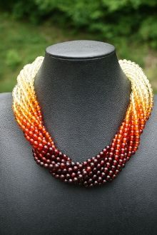 Variegated color of highly polished Amber round beads.