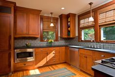 Teakwood Builders of Saratoga Springs, created a custom kitchen with Arts & Crafts appeal to integrate with the rest of an historic Craftsman bungalow in Saratoga Springs, New York.