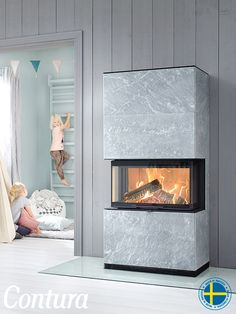 Fireplace Contura i51T in soapstone.  Supplement with powerstone under the cover to retain the heat much, much longer.