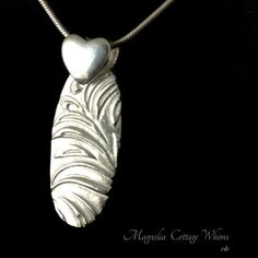 Fine Silver Oval Pendant with Reversible Paisley and Feather texture and SS Heart Bail by Magnolia Cottage Whims $35.00 ACS, Fine Silver Jewelry, Artisan Jewelry, Precious Metal Clay Metal Clay Jewelry, Silver Jewelry, Unique Jewelry, Feather Texture, Precious Metal Clay, Oval Pendant, Selling Jewelry, Sell On Etsy, Artisan Jewelry