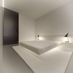 A simple white bedroom is incredibly serene.