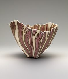 Curtis Benzle 1975. Benzle's work is made with colored vitreous translucent porcelain. Much of the nonfigural imagery of his bowls is co...
