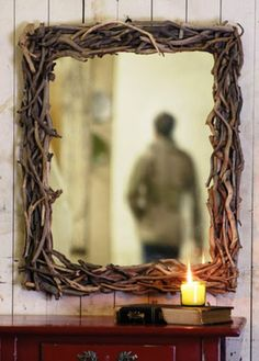Collect dried twigs and/or driftwood.  Hotglue and layer on a plywoodframe.  Very effective and stylish mirror frame!
