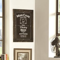 This piece or art is designed with men in mind. It reads 'man cave - good times - drink whiskey, beer, vodka or anything - just keep calm and drink on' to suit any hang-out pad. The reclaimed wood alo