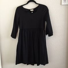 Black dress w/ half sleeves Longer black dress with quarter sleeves. Super cute and comfy. NWT. has never been worn before and is a really great dress! Urban Outfitters Dresses Mini