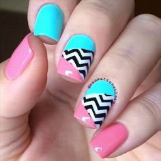 Try out baby colors for your winter nail art. Check out this amazing combination of baby pink, baby blue, black and white colors with zigzag patterns on.