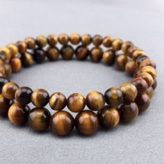 Set of 2 tiger eye bracelets Handmade elastic set of 2 genuine tiger eye stone. After purchasing the listing please comment below what size you want Jewelry