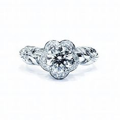 Custom designed engagement ring round cut halo style in the shape of a flower! Beautiful flower shape ring