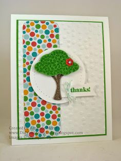 Lotsa dots and a green flowering tree - use your embosser for the dotted panel and patterned paper to add the colored circles. The tree leaves are popped up for dimension, and the flower has a rhinestone for some bling.  DIY thank you card