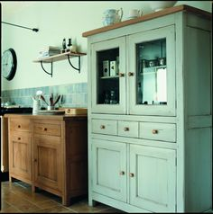 Freestanding units in different colours.  Didn't know fired earth made kitchens.
