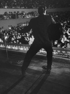 Elvis Presley performing at the Municipal Auditorium in Amarillo, Texas, on April 13, 1956. Photo by A.Y. Owen.