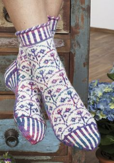 For a sock knitting challenge, make these beautiful jacquard socks with all-over floral motifs, two-color ribbing and a corded edging. They are especially lovely using a solid color of REGIA to contrast with a color-effect yarn. Fair Isle Knitting, Knitting Socks, Hand Knitting, Knitting Patterns, Knit Socks, Cozy Socks, Patterned Socks, Knit Or Crochet, Winter Wear
