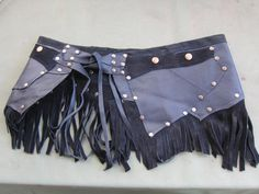 BURNING MAN belt/skirt....leather with suede fringing and 2 pockets..33 across plus long ties..