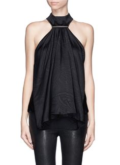 Generously cut-in at the shoulders, this textured silk top from Jason Wu is highly flattering for day-to-evening wear. Formal for smart appeal yet stylish for a night out in town, the waterfall ruffle front and high collar make it a covetable piece for year-round dressing. Topped with a silver-tone metal bar, your collar bones are highlighted with an effeminate touch.