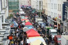 One of the best places to be!  The flea market,on Portobello Road, in London.
