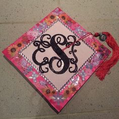 My monogrammed graduation cap! I did the monogram myself with paper, glue, and glitter! Each type of flower represents someone I lost along the way getting here.