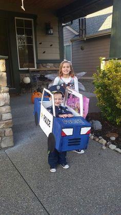 Cardboard Police Truck- cardboard + duck tape + razor blade + paint = a little kids dream truck.