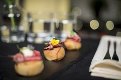 Wedding canapés - yorkshire puddings with rare roast beef, horseradish and gravy