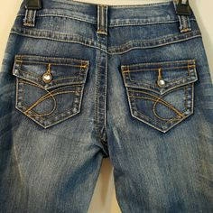 INC Jeans.  Regular fit. Boot Leg INC Jeans with adorable rhinestones detailing on the front and back pockets.  The jeans are brand new but the tags are not on. INC International Concepts Jeans Boot Cut