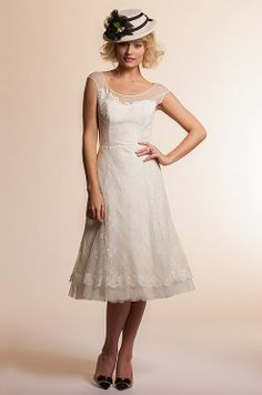 Short wedding dress from Amy Kuschel, 2013...just minus the hat.  Actually REALLY like this!