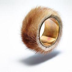 Fur bracelet, gold. Meret Oppenheim.