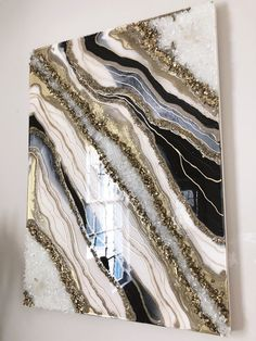resin art This white, black and gold resin geode measures at inches. The glass like surface of resin provides a high end look to any space. The use of quartz crystals bring positive energies into your home. Resin Wall Art, Epoxy Resin Art, Diy Resin Art, Resin Artwork, Diy Resin Crafts, Diy Art, Resin Paintings, Acrylic Pouring Art, Acrylic Art