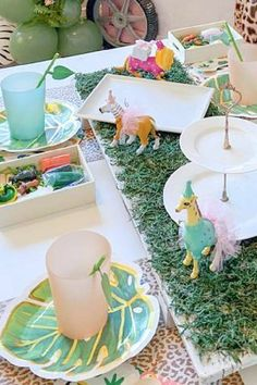 Check out the awesome table settings decorated with fun animals in party hats at this zoo birthday party! See more party ideas and share yours at CatchMyParty.com